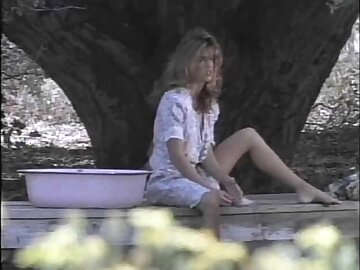 Gorgeous woman takes a bath and masturbates handy a wading pool