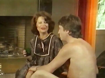 Busty and sex-mad German milf little one on the couch feding on a dick